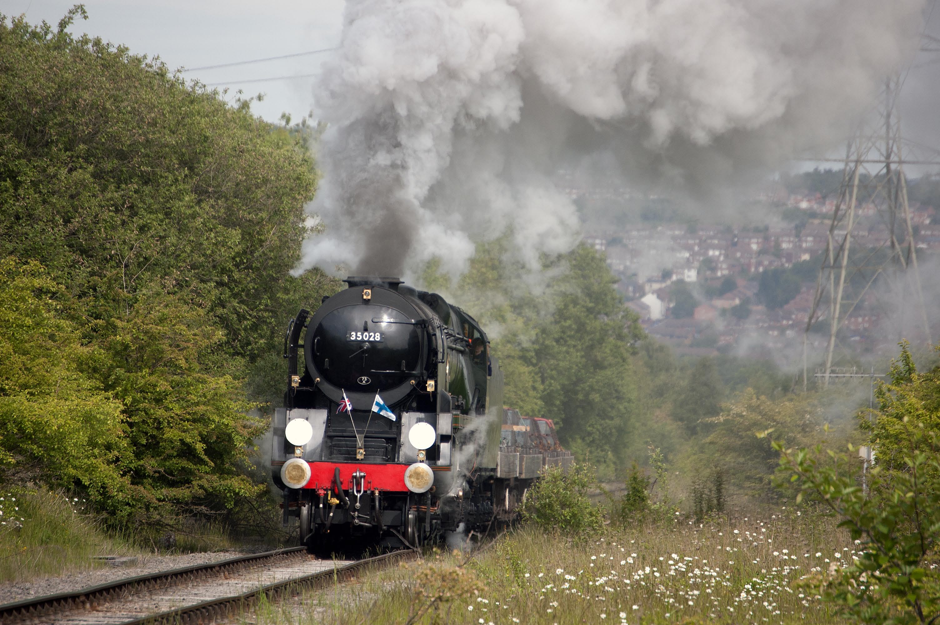 Clan Line hauling a heavy freight train up the climb at Outokumpu Steelworks