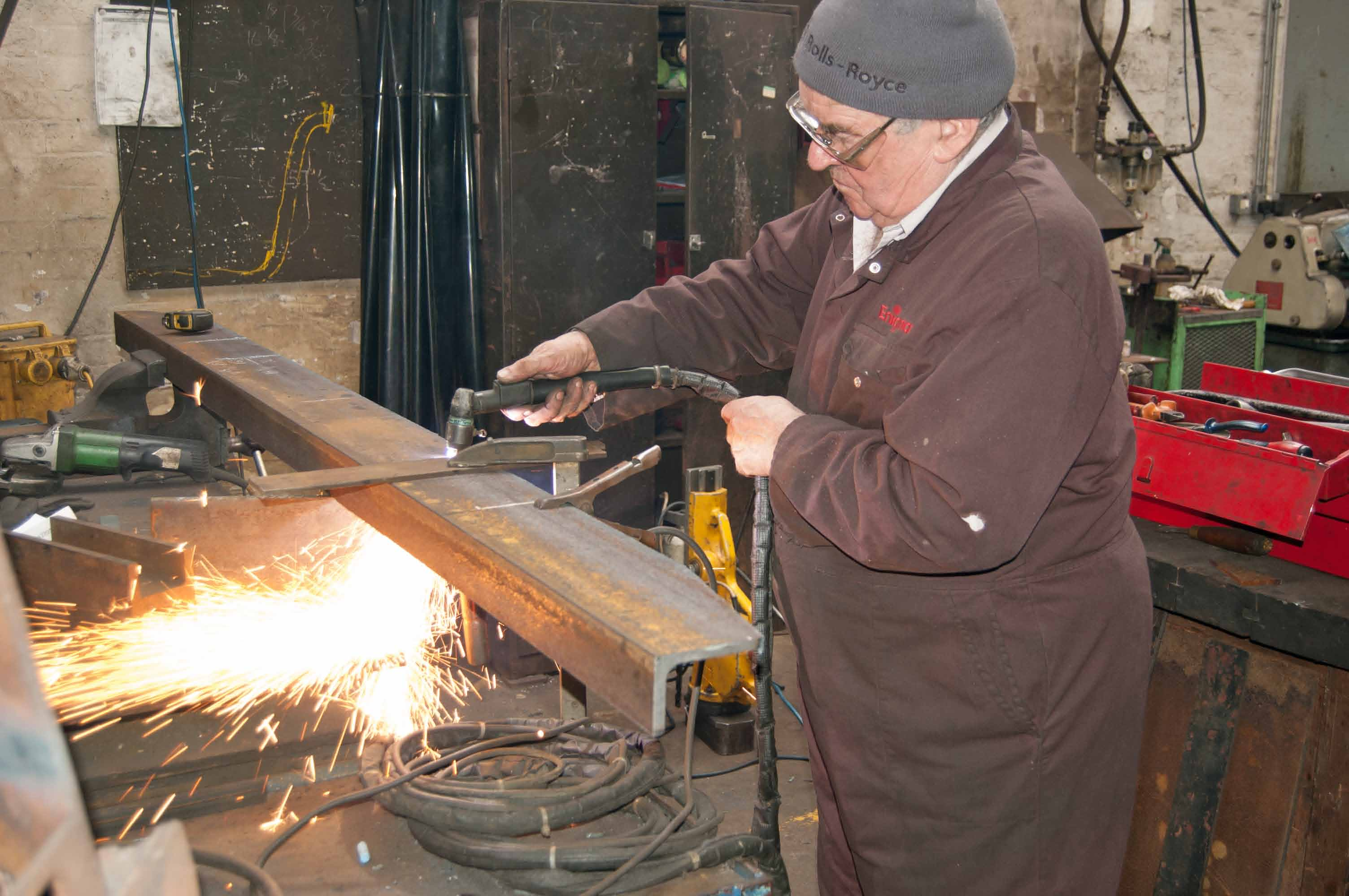 The plasma cutter is being used to cut the newly acquired piece of metal into shape