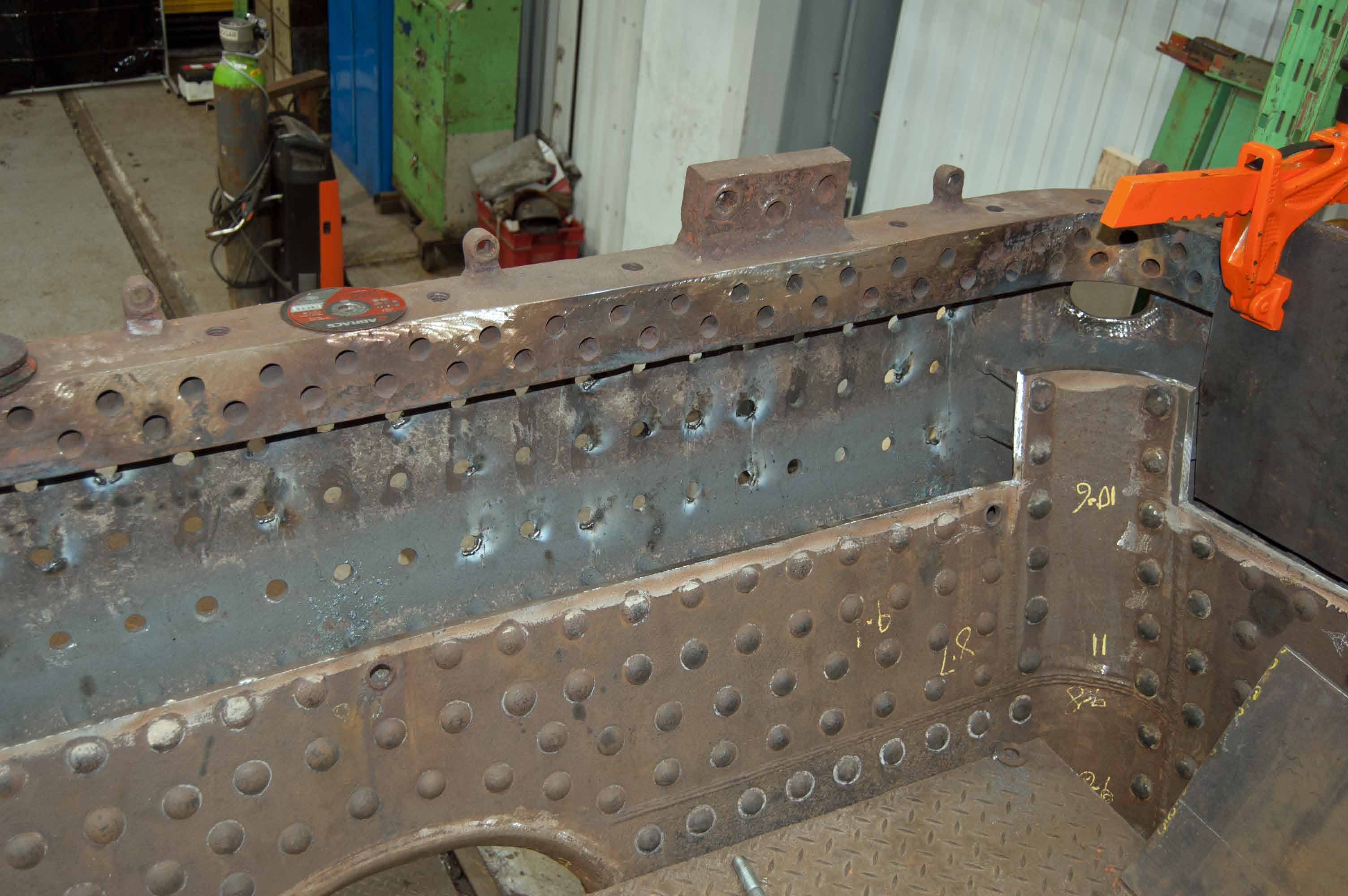 The rear part of lower inner firebox has been cut away, and is being prepared for the new platework to be welded in.