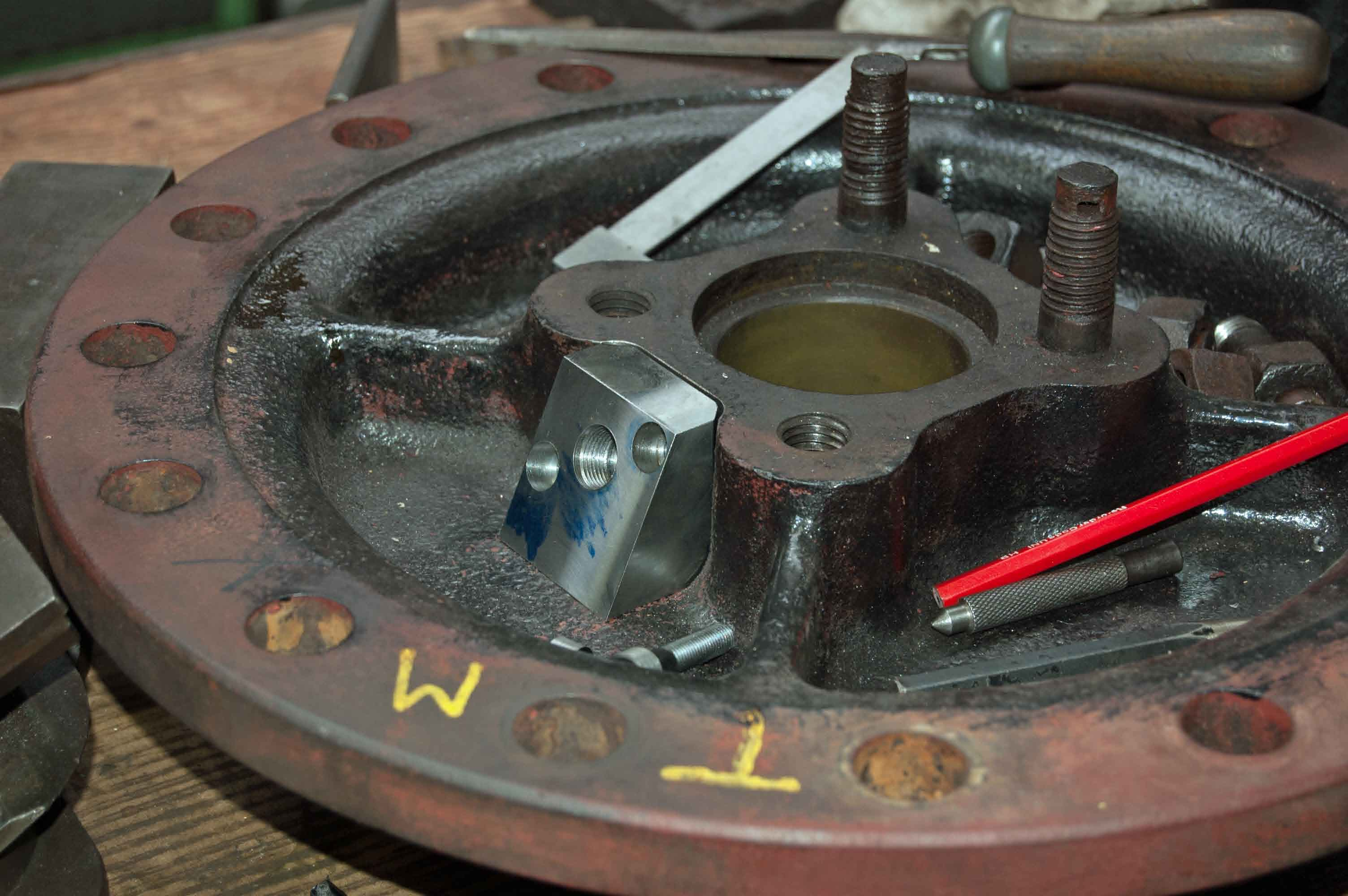 The modifications to the middle valve front cover, to improve the lubrication, are progressing