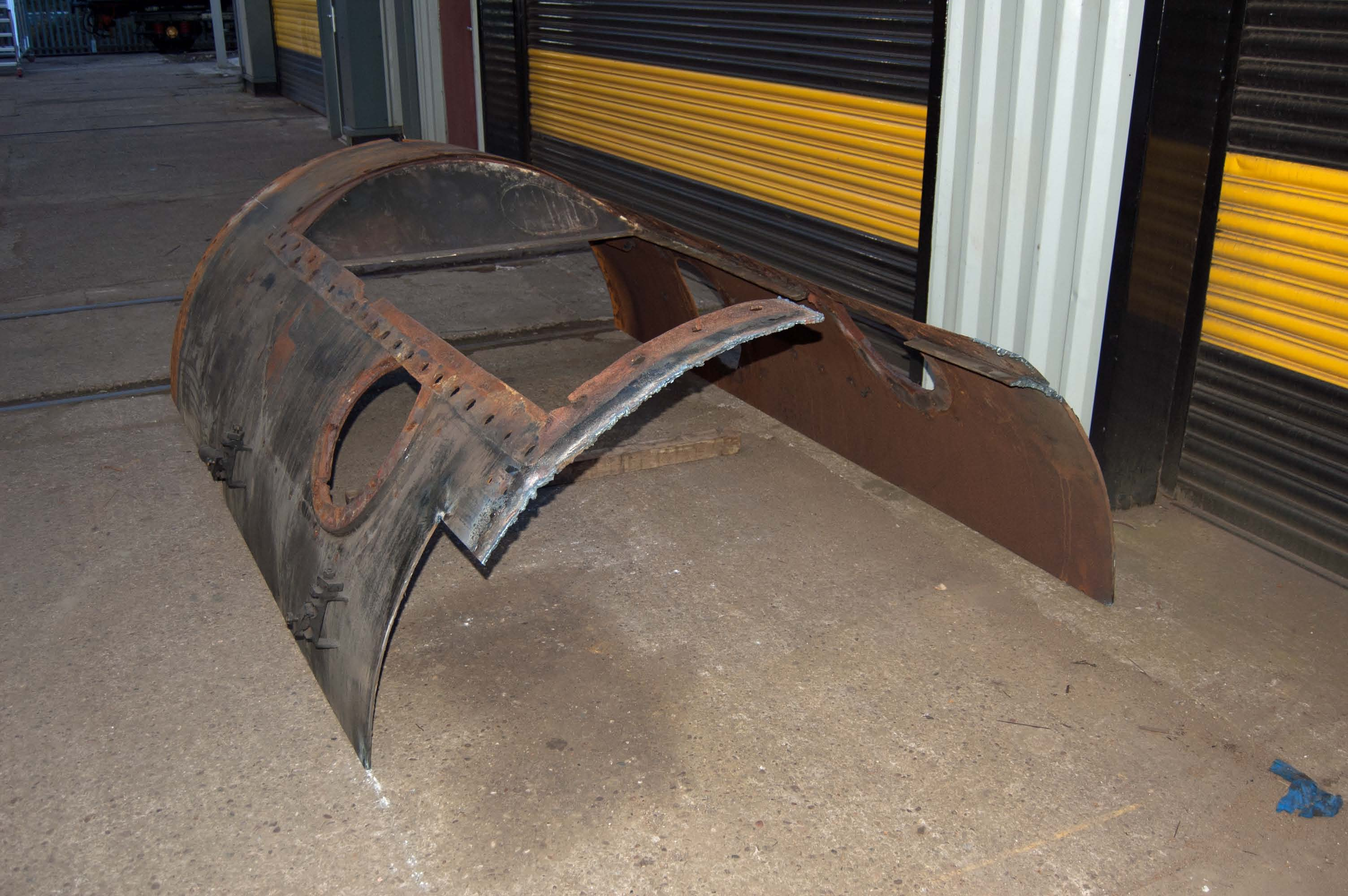 The bottom part of the smokebox is corroded and needs replacing. It is easier, and no more expensive, to replace the whole bottom half. This is the old bottom half.