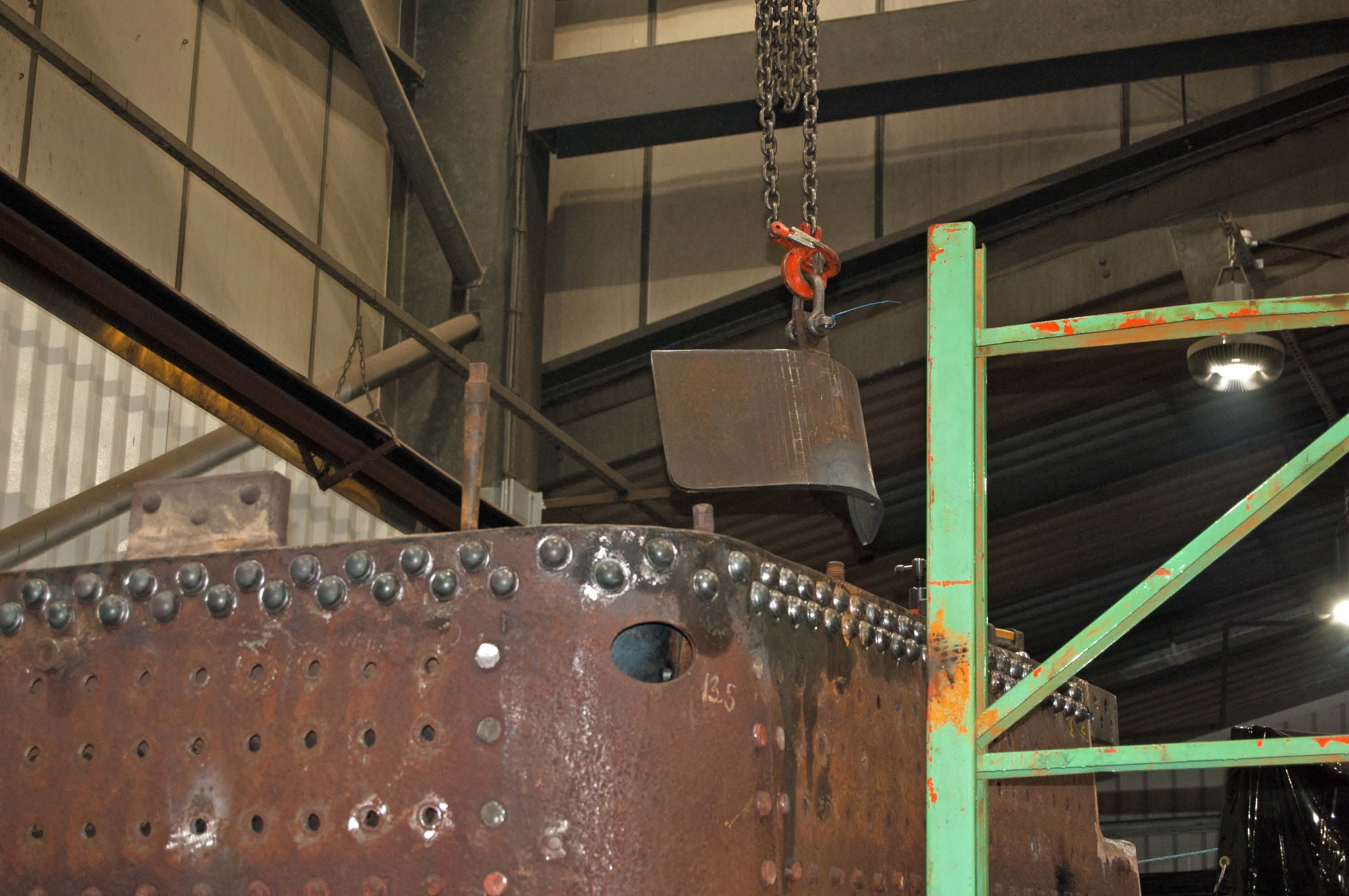 The next piece of boiler plate (the left hand lower front corner of the outer firebox) is being prepared.