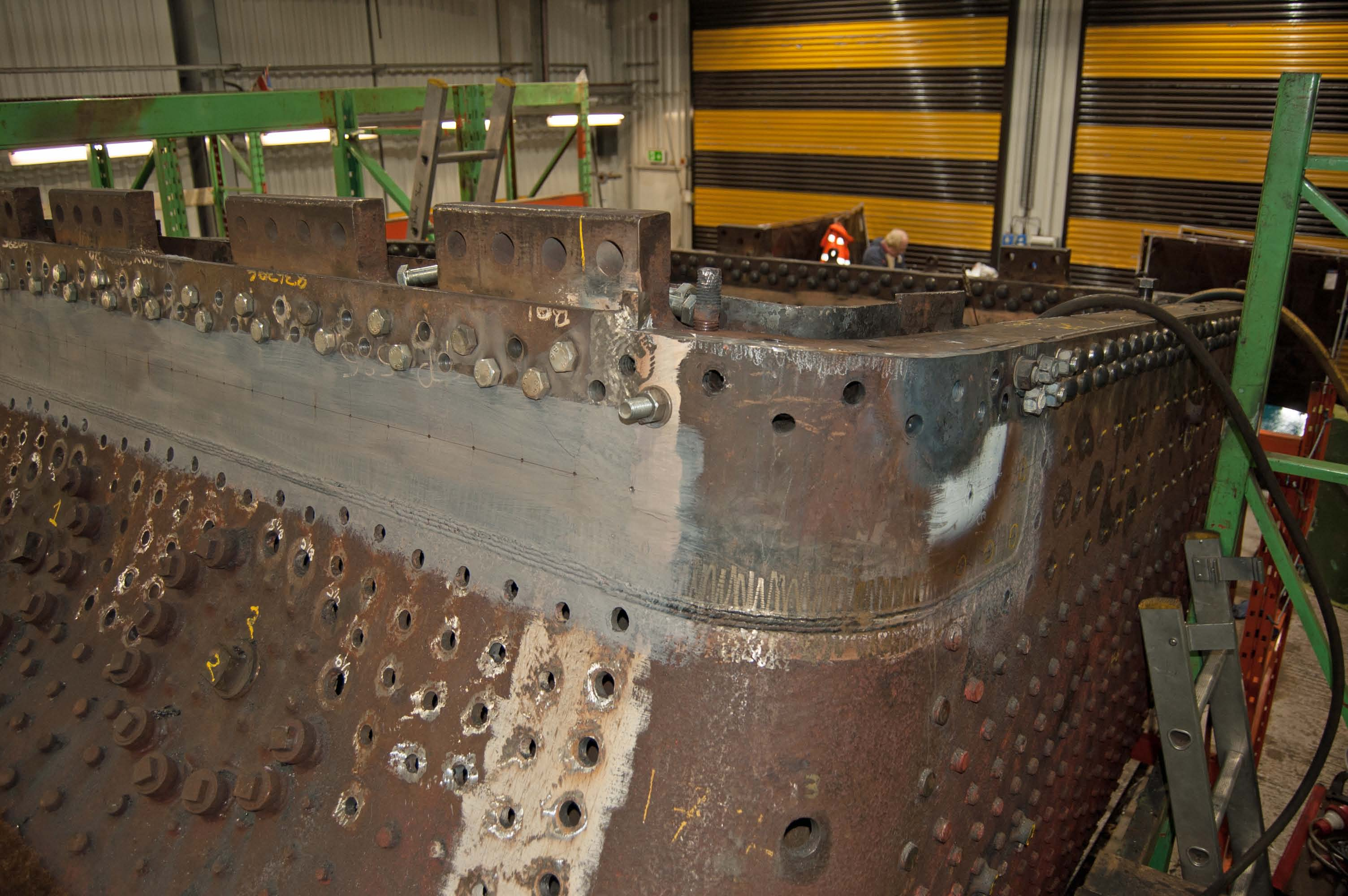 The final side of the foundation ring is prepared for riveting